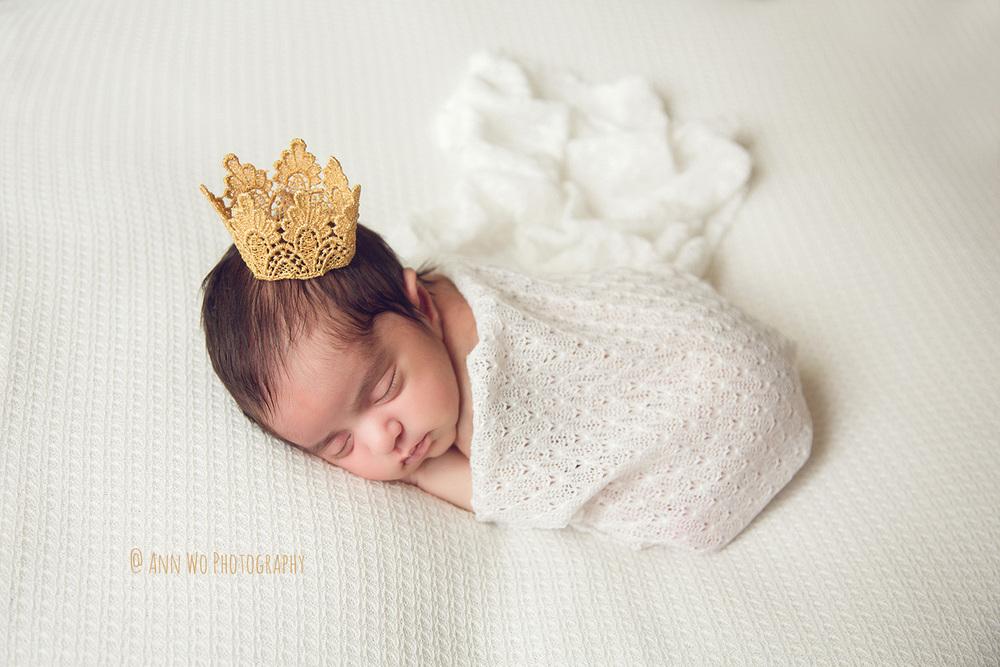 ann-wo-newborn-photo-princess-crown-wrap-white-posing-fabric.jpg