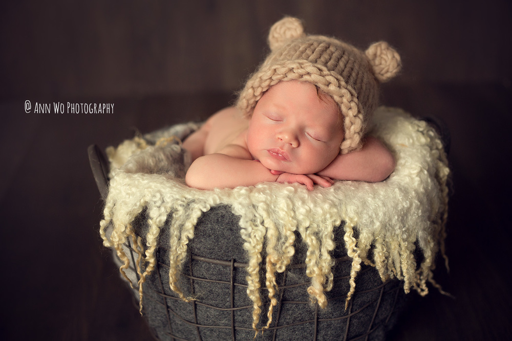 Newborn photography in London by Ann Wo bear hat metal basket
