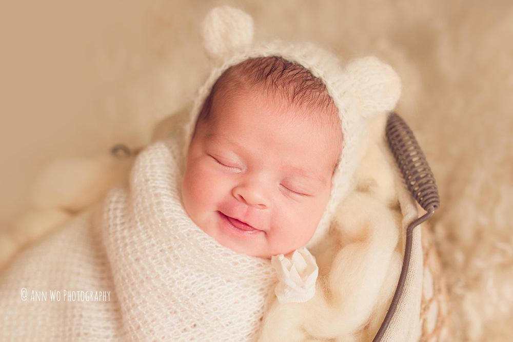 Newborn photography in London by Ann Wo cream bear hat smile