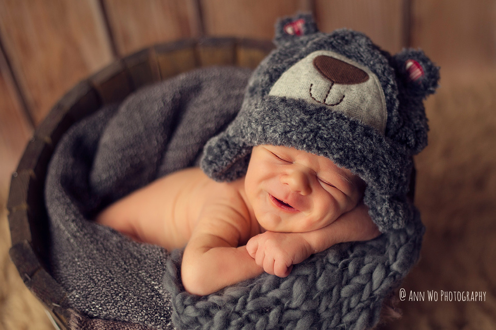 smiling-newborn-photographer-ann-wo-london.jpg