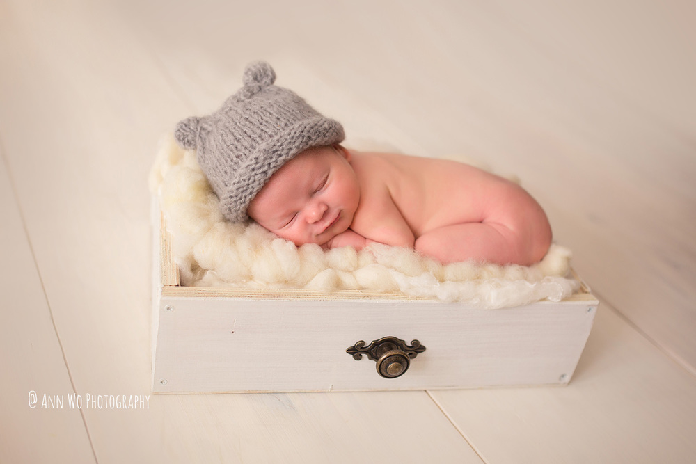 Newborn photography in London by Ann Wo rustic white drawer