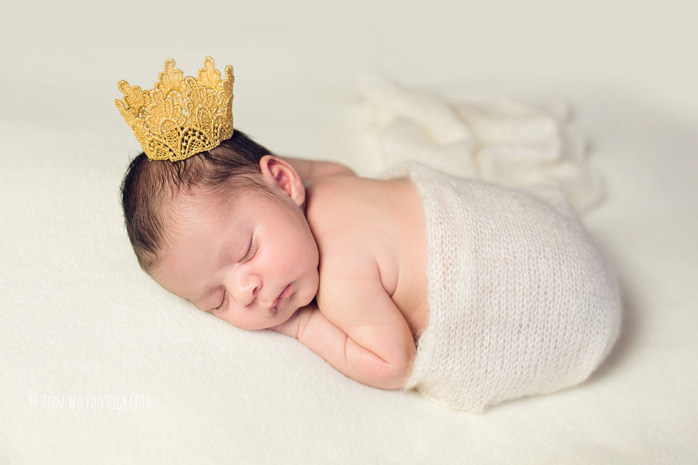 Newborn photography - baby girl with crown and knitted wrap - Ann Wo