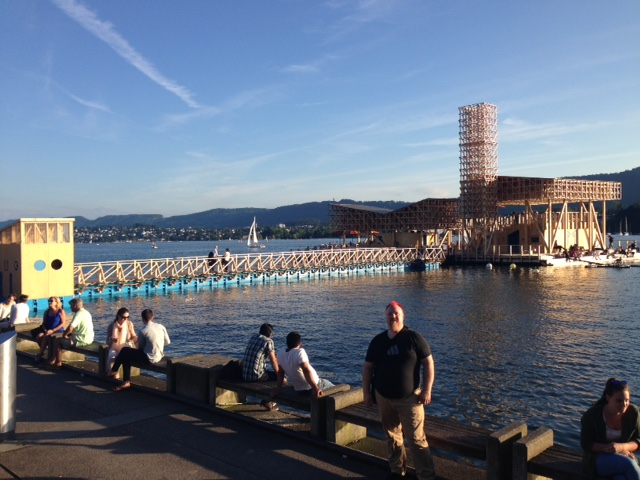 Here is John enjoying a trolley stop at the postcard-perfect lake in downtown Zurich.