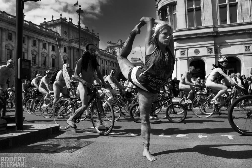 51) Sarah Thompson:  The World Naked Bike Ride Passing Through Parliament Square, Westminster  (London)