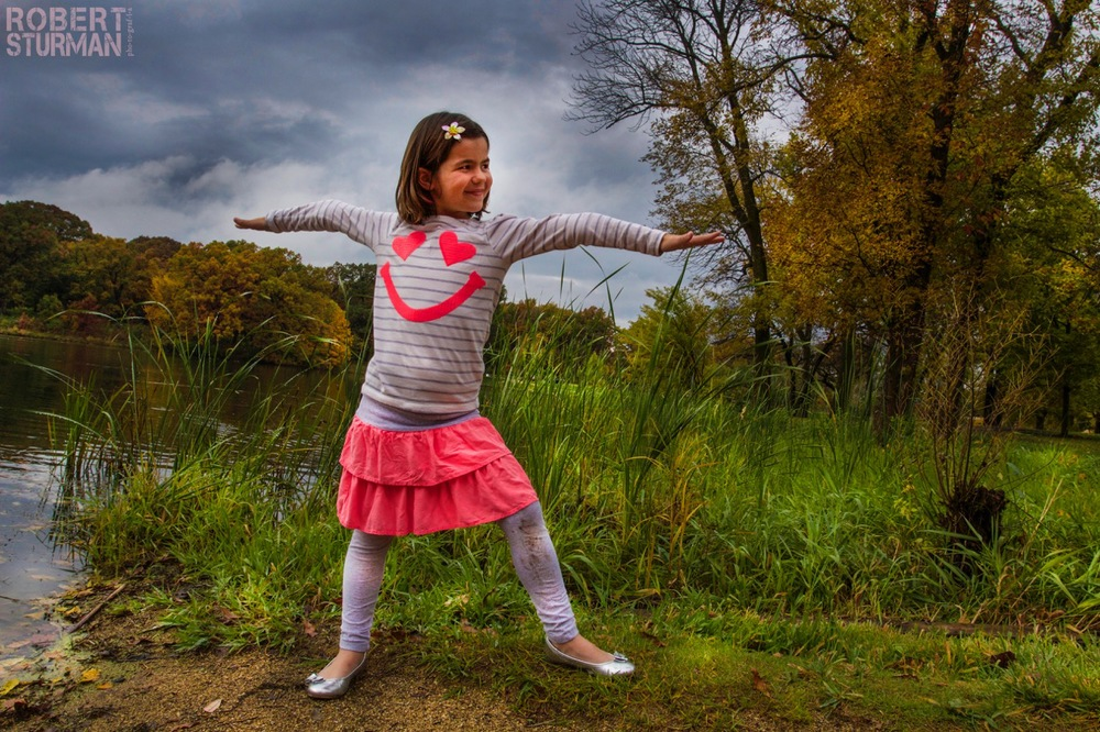 "85) When I asked seven year old Chloe what pose she would like to do, her sweet voice and heart slowed everything down and lit up the world, as she explained why. ""I chose the warrior pose because I am a cancer survivor and I feel like I can do anything now! I am so strong!"" Chloe Gelber, pictured at Herrick Lake in Wheaton Illinois, was diagnosed with leukemia (PreB ALL) when she was 4 and endured two plus years of treatment. She completed treatment in April and is doing well."