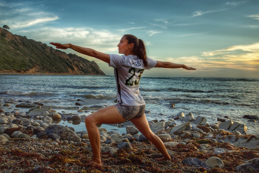 64)  United States World Cup Soccer Champion, Christen Press: Palos Verdes, California My interest in photographing celebreties practicing yoga, is the game changing potential that it carries with it. The yoga cultural crossover into a massive mainstream arena of millions of fans seeing one of their favorite athletes embracing the practice. The more pictures, the more 'normal' it becomes. Photographs change the world.