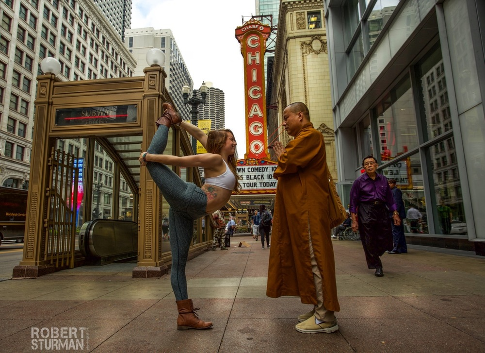 74)   Cassandra Justine photographed on the streets of Chicago, being blessed by a passing monk