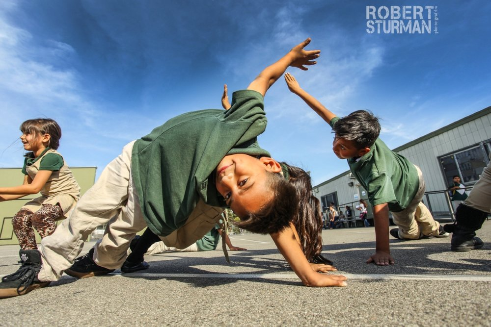 50) Being with the seven year olds is everything! A great day of yoga in Boyle Heights - Los Angeles, California - with Uprising Yoga at Extera Public Elementary School. Vashistasana never looked so good.