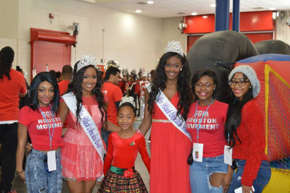 Miss Black America Coed Roneshia Ray and Miss Black American Teen Kaylah Baker volunteering at Congresswoman Sheila Jackson Lee's annual Toya for Tots. Roneshia and Kaylah were participates in the parade as well as a guest speaker and provided entertainment.