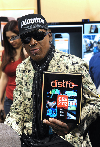 Dennis Rodman, showing off Engadget Distro magazine.