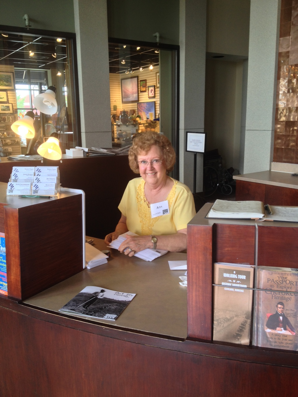 Museum Center at 5ive Points volunteer, Ann Cherry, assists with a mailing at the front desk.