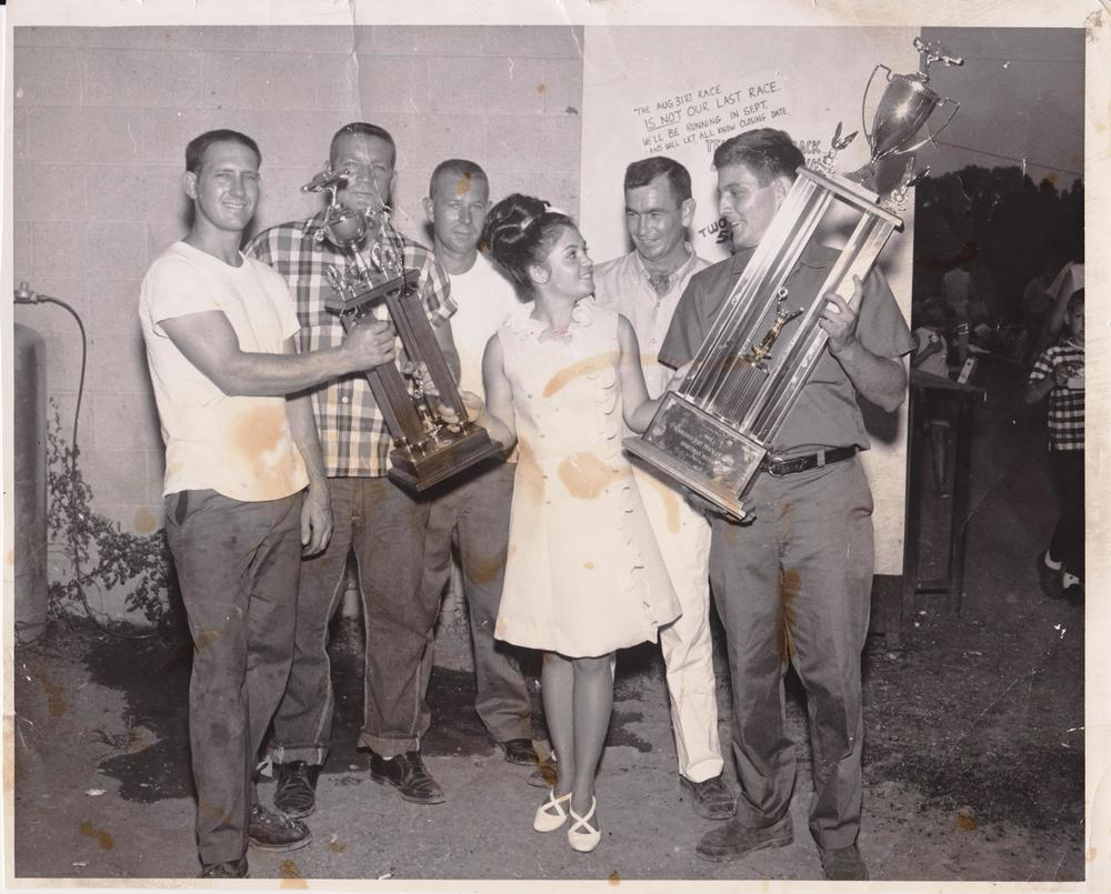 Tommy Fryar (right) accepting his 1968 Tennessee Dirt Track Champion trophy in Sportsman Division. Photography on loan by Tommy Fryar.