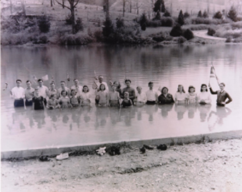 1999.053.009, Print, Photographic,  Outdoor water baptism conducted by the Church of God of Prophecy.