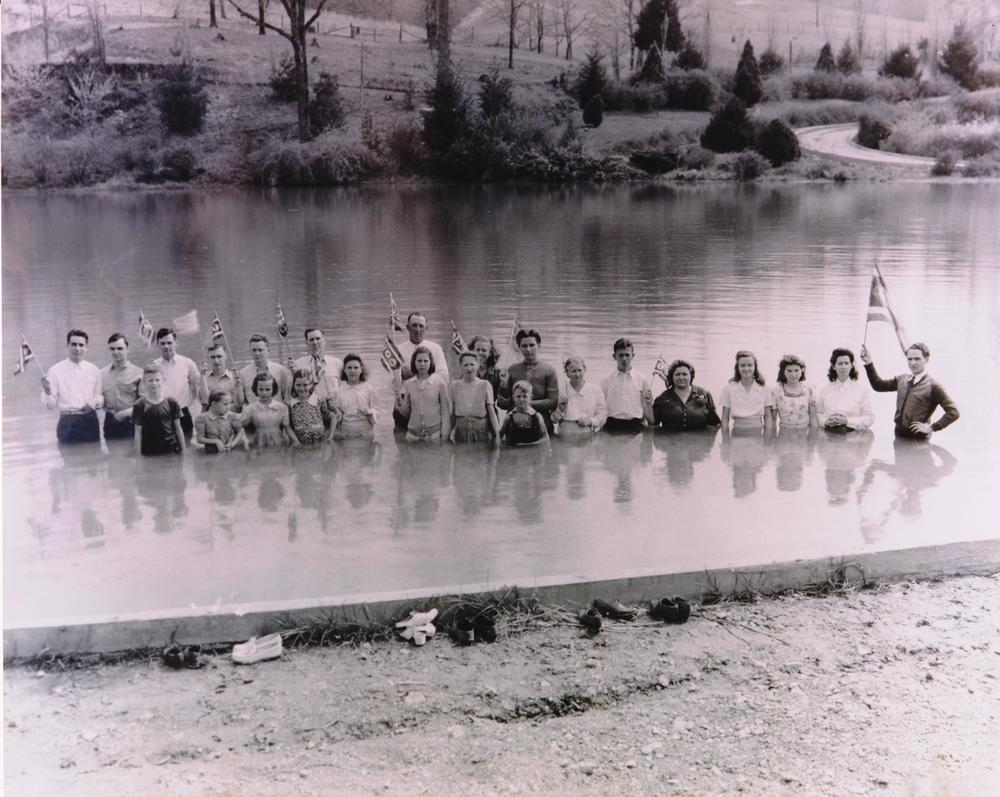 An outdoor water baptism service conducted by the Church of God of Prophecy.
