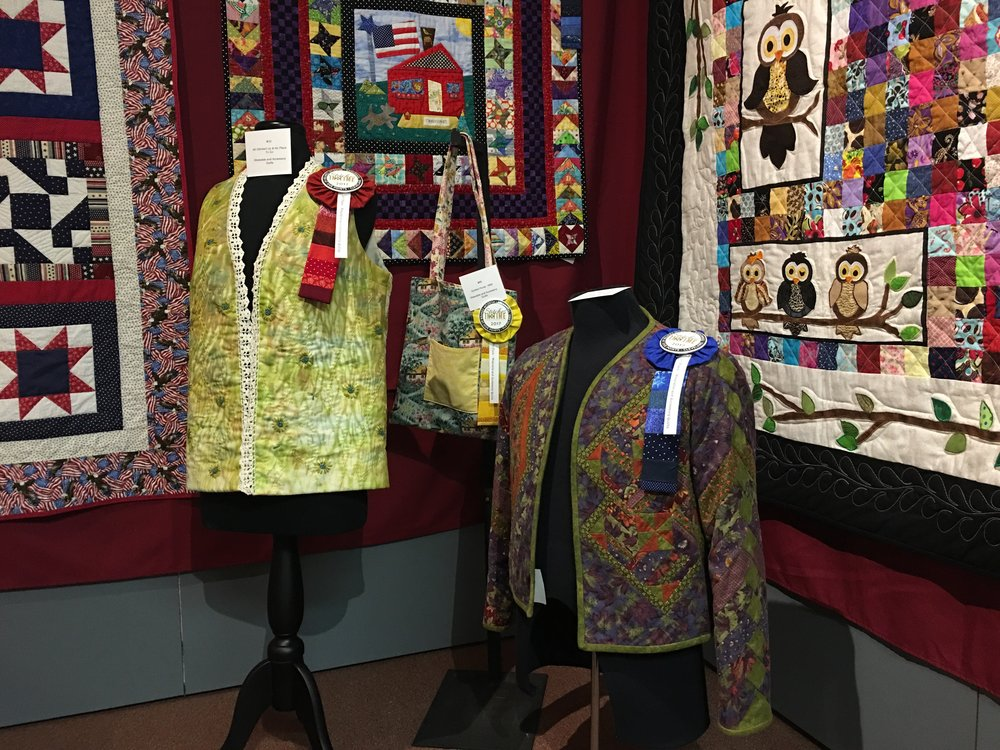 1st Place Wearable & Accessory Quilts: A Sampler Jacket entered by Phyllis Callaway (right)