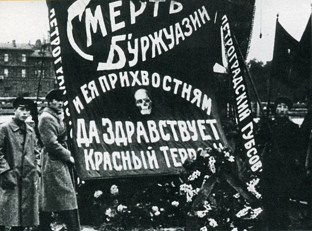 """Death to the Bourgeoisie and its lapdogs - long live the Red Terror"" sign in Petrograd (now St. Petersburg) in 1918."