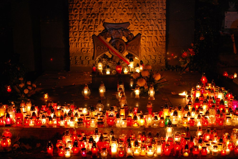 Candles in Poland put out for All Saints' Day in a graveyard.