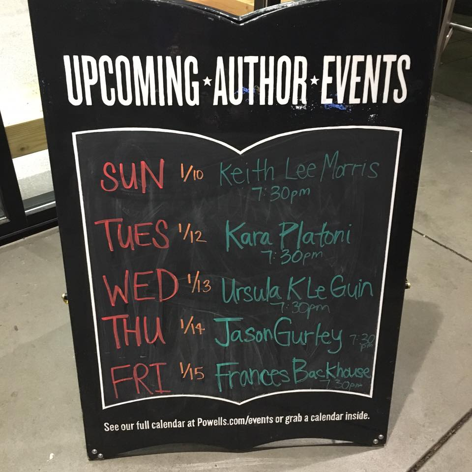 Signboard of author events outside the entrance to Powell's.