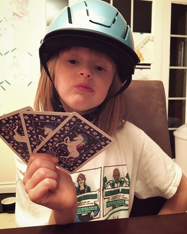 Couple pre-bedtime hands of Go Fish with equestrian Squish.