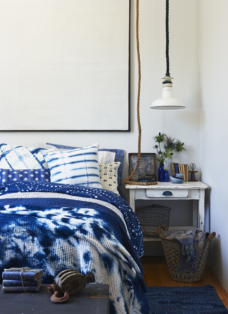 Light, $175, Oyster Bucket, $85, P and B. Nightstand, $269, Cornerstone. Square tray, $165, Books, $250, Kantelberg+Co. Porcelain bowls, $4–$6 each, Indigo. Polka Dot duvet, $250 (Queen), The Bay. Throw blanket (On bed), spool, prices on request, Latre Art + Style. Throw blanket (in bucket), $199, blue pillowcase, $36/set of 2, Zara Home. Blue vases, Wire basket, geometric pillow, stylist's own. Pillowcase (for dyeing), $9, Ikea. Wood Handle, $2, Lee Valley. Rope, $20, Ropeshop.ca. Artwork, Ron Ackroyd