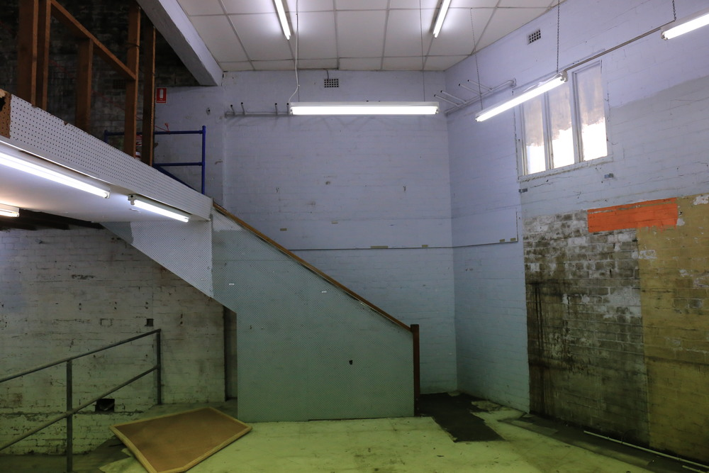 Stairs from the lower level to the upper level in the original building
