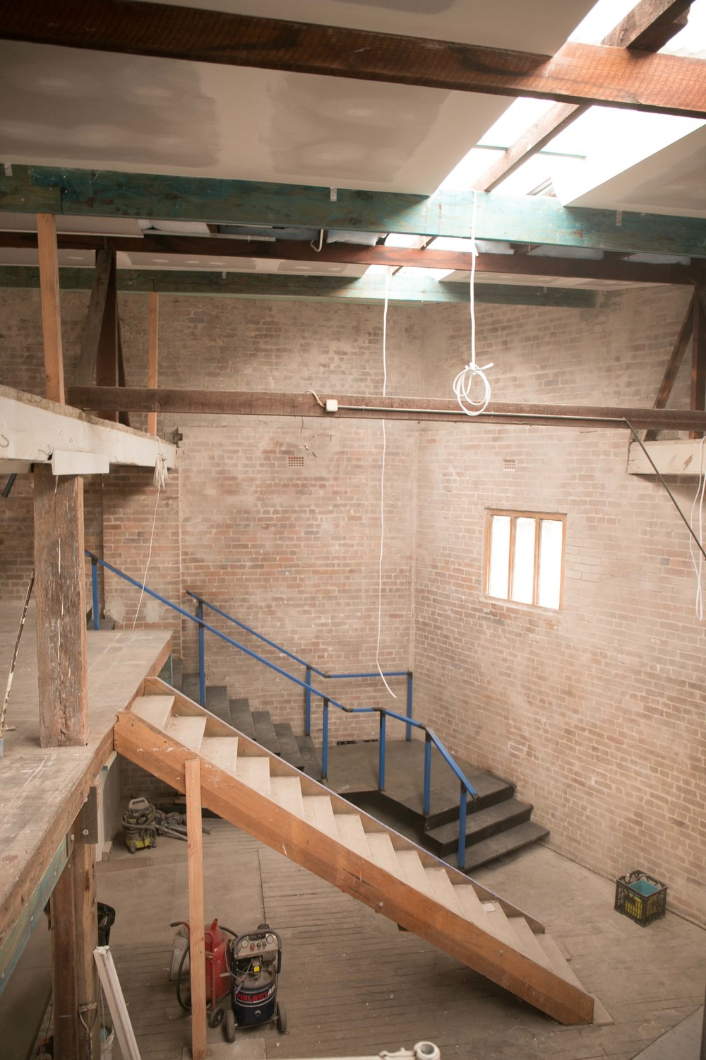 The old stair moved temporarily to make way for the new steel stair and balustrade to be installed.
