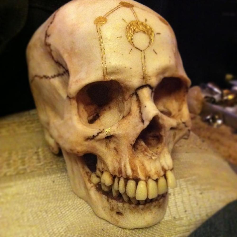 Strange Gilt Skull found in the locked office of Doctor Anthony Vestagé, Professor of Occult Studies