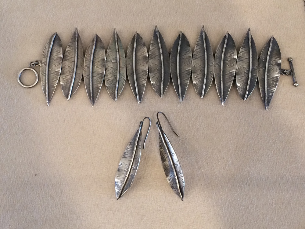 Reservoir 4: Oxidized Silver Feather Bracelet and Oxidized Silver Earrings. These are designed by a local Eagle Rock artist.