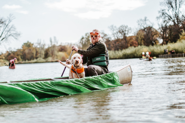 My husband Nate and our pup Juniper in our Juniper themed canoe at The Canoe Parade.