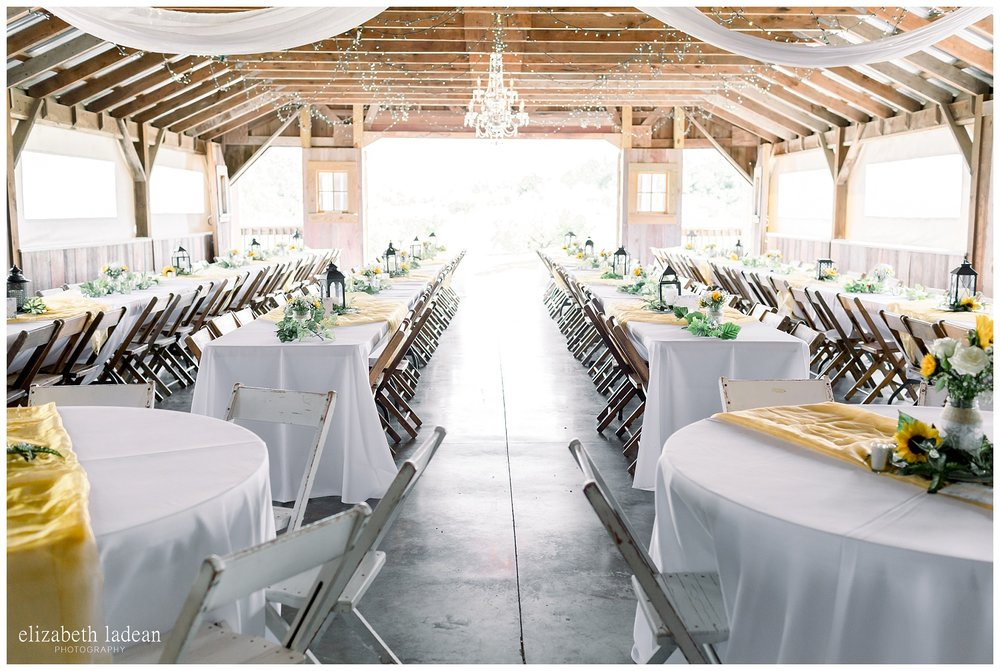 Weston Red Barn Farm wedding reception with farm tables