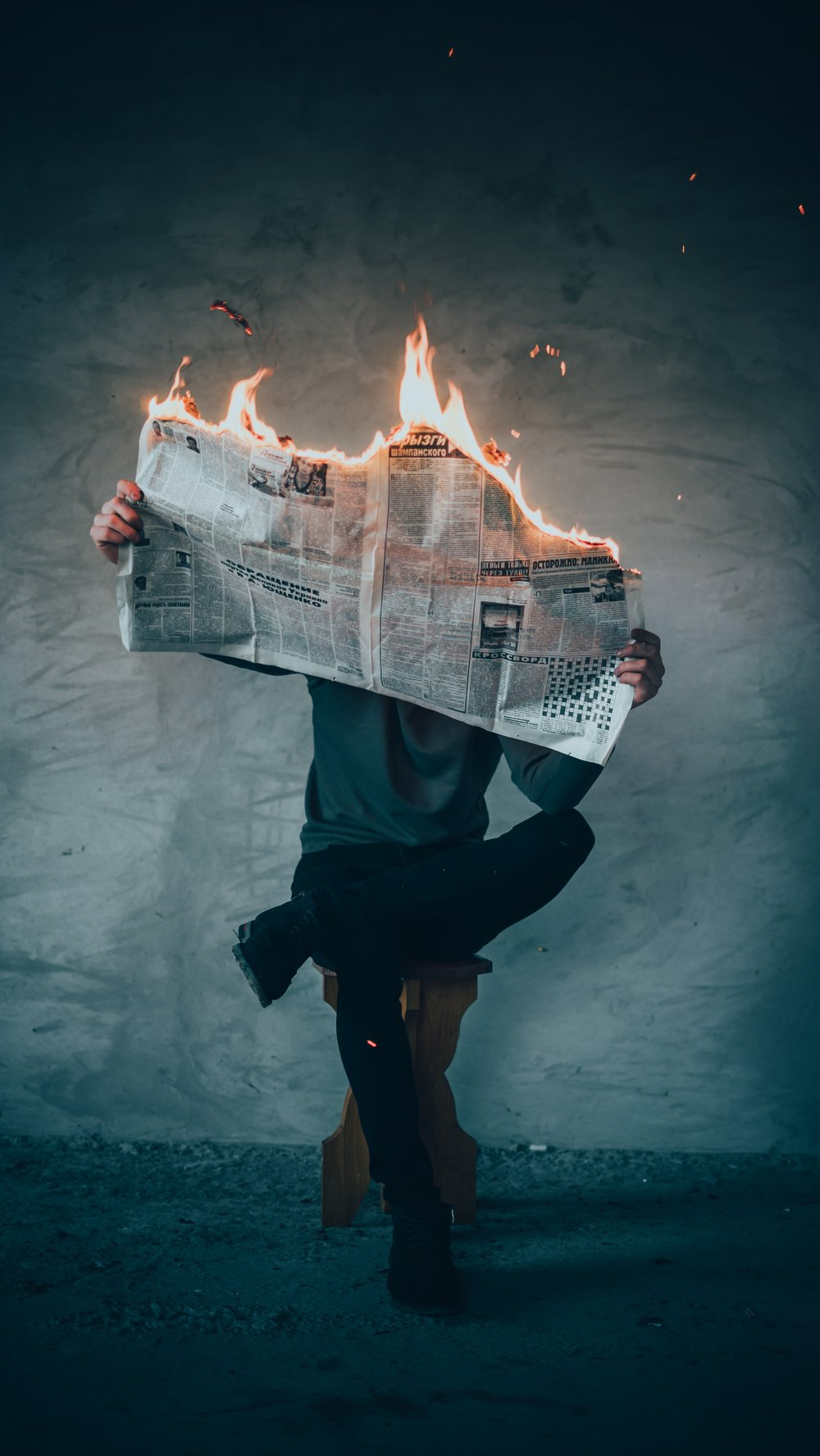 person-reading-newspaper-on-fire-elijah-o-donell-603766.jpg