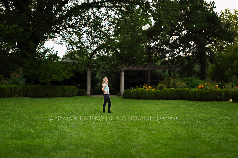 theresa stands in the grass at Ault Park, Cincinnati Ohio