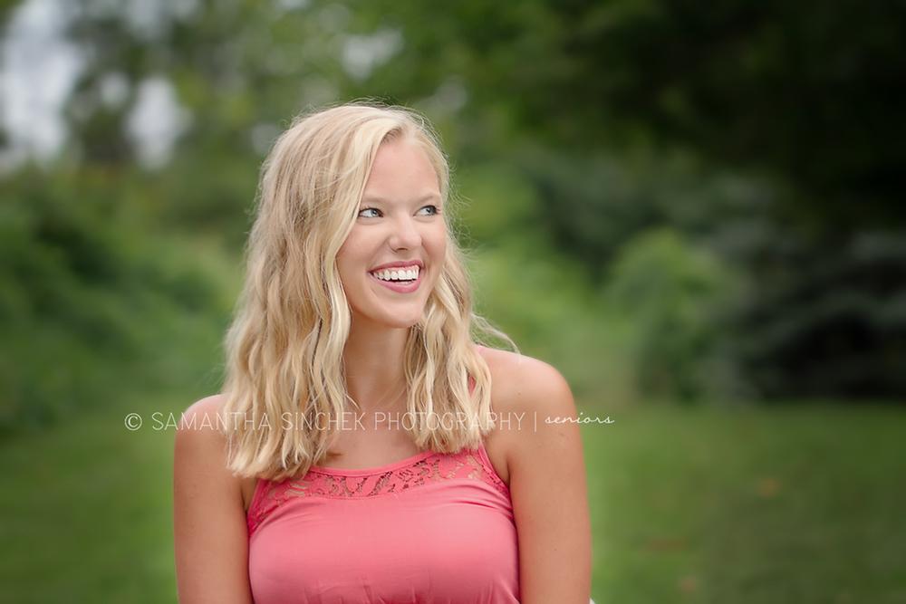 beautiful CINCINNATI senior laughs during senior portrait session