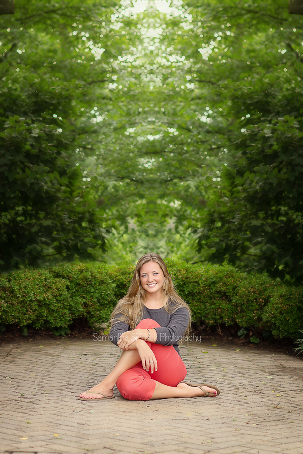 alyssa sits in a gazebo at Ault Park for a SENIOR PHOTO SESSION