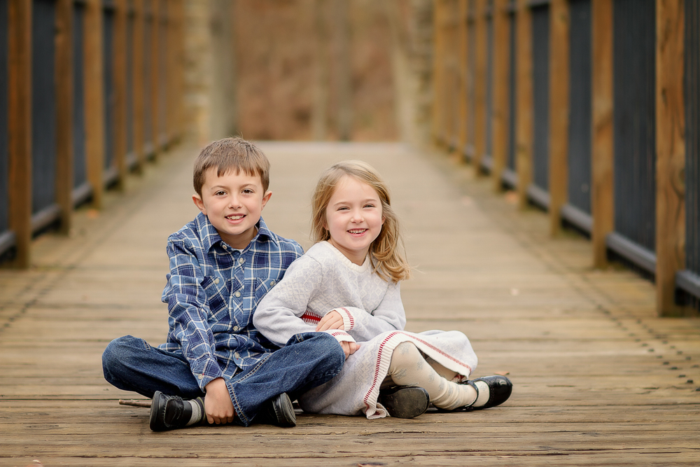 siblings smile during a photo session with Samantha Sinchek Photography
