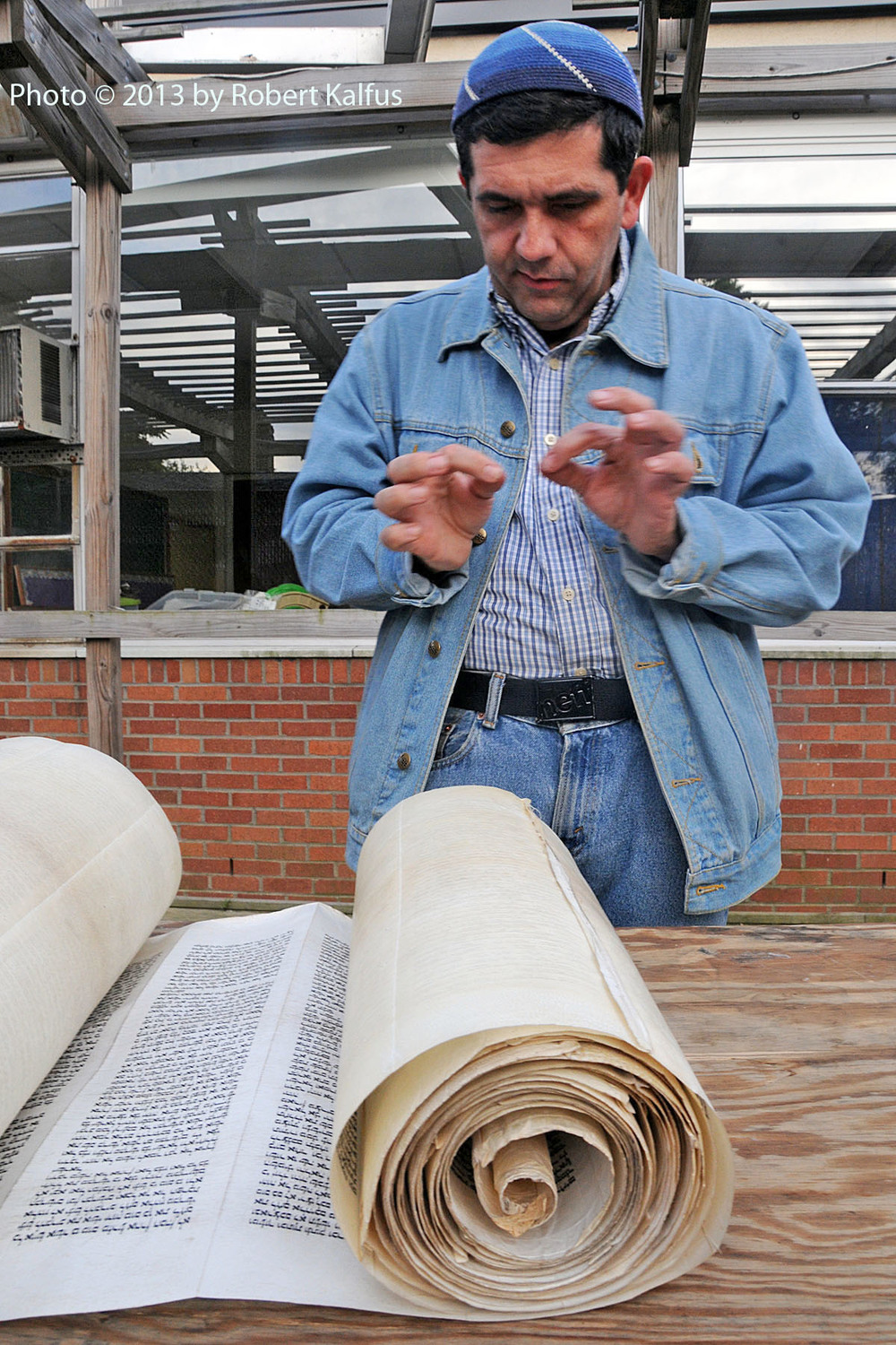 "Rabbi Viñas uses ""Gid"" (animal sinew) to sew an Iraqi Torah scroll destined for Ecuador"