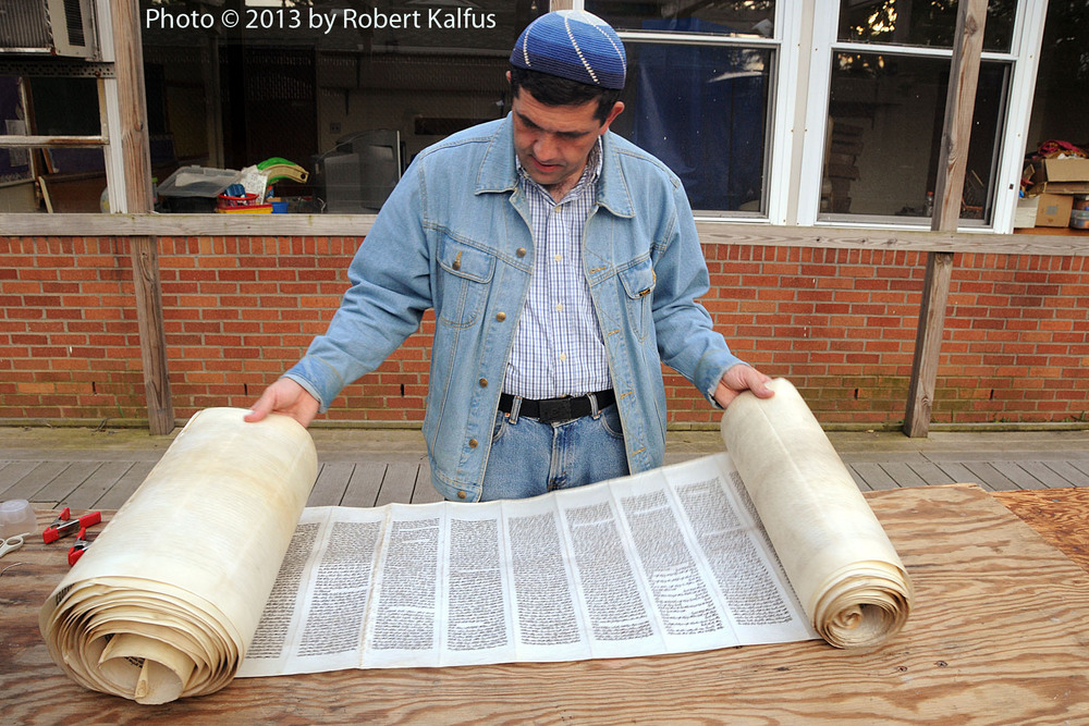 Rabbi Viñas checks an Iraqi Torah scroll destined for Ecuador (1)