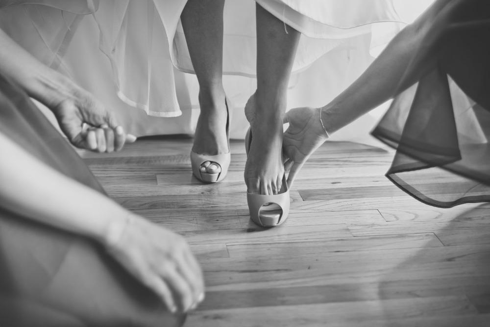 20120902171622_bride_slipping_into_shoe.jpg