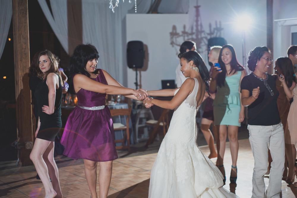 20120902231411_bride_bridesmaid_dancing.jpg