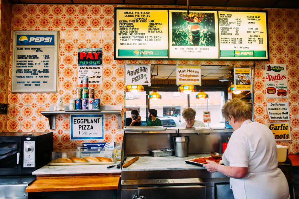 the-new-york-pizza-project-johns-pizzeria-elmhurst-shop-wall.jpeg