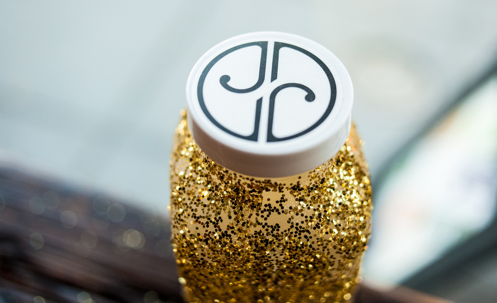 JRINK juicery design logo bottle