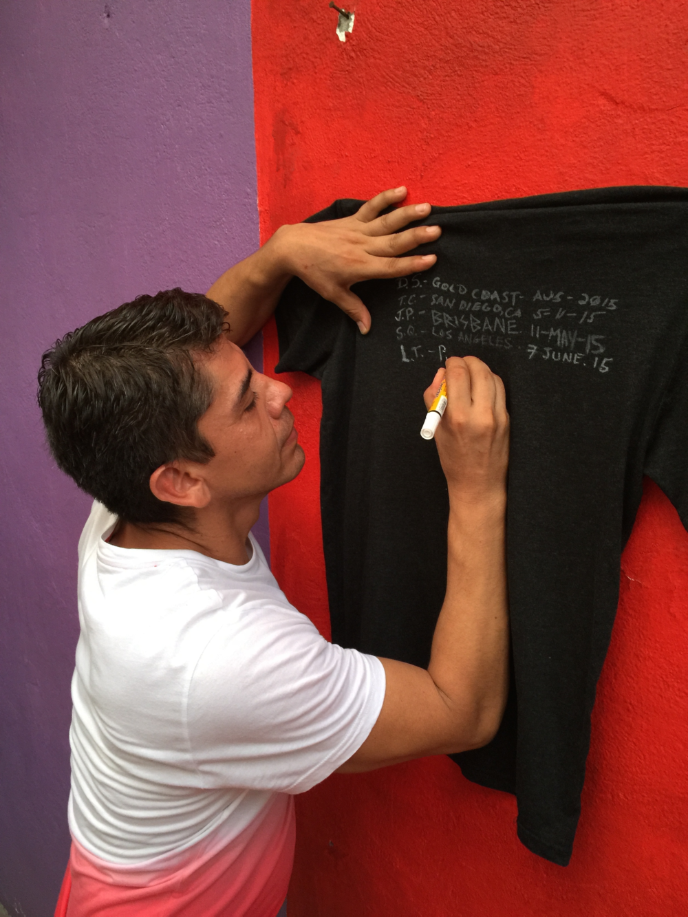 Leo signs the Do-Gooder shirt in support of our friends in Ecuador who need clean water as a result of years of oil pollution. You can too by donating  here .
