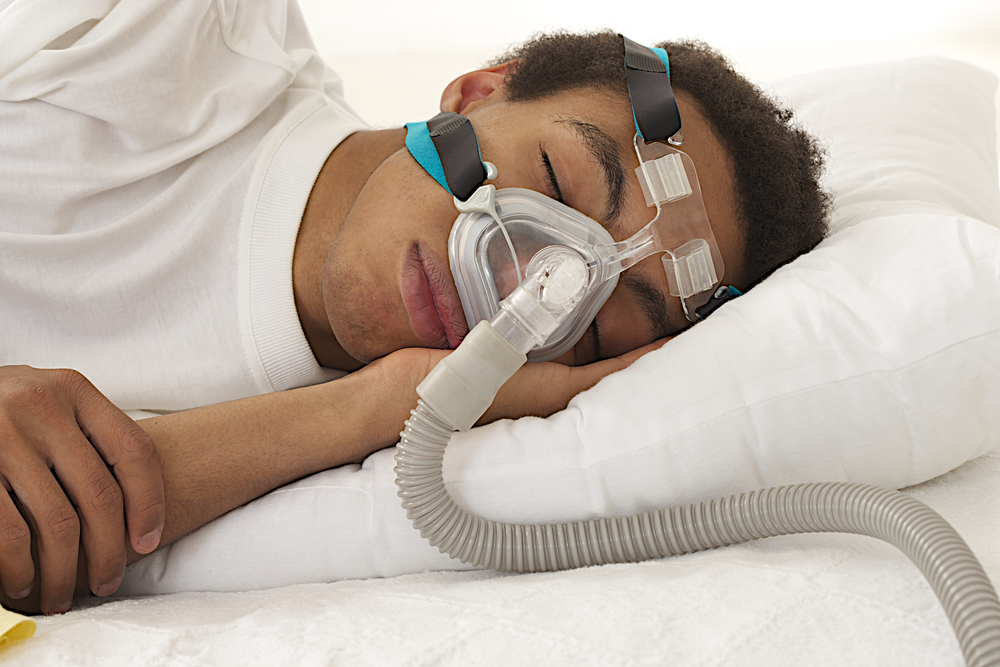 "C-PAP:  This oxygen delivery system gives patient oxygen in liters per minute or percentage of the air that is oxygen (meaning that the air delivered is 50% oxygen). CPAP stands for continuous positive airway pressure. This is most commonly prescribed at home for patients that have sleep apnea and need the added support of this ""positive airway pressure."" The muscles in these patients airways relax while they are sleeping and cause an ""obstructive"" sleep apnea. The extra pressure keeps their airway open and allows them to breathe normally. The doctor prescribes the set extra pressure that the c-PAP will deliver. In addition to this, the doctor will prescribe the amount of oxygen needed for the patient. Usually if someone is still showing signs of having respiratory failure with a non-rebreather mask, doctors will ask that the patient be placed on bi-PAP instead of c-PAP. C-PAP is usually more of a long-term care treatment. The mask for this treatment can either cover just the nose or cover the nose and mouth (like the bi-PAP mask below)."