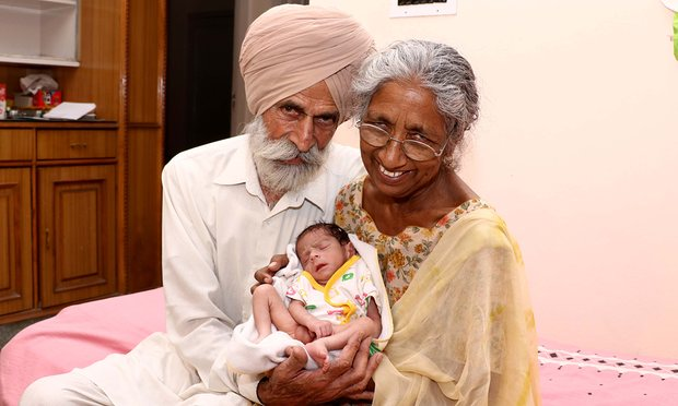Daljinder Kaur and her husband Mohinder Singh Gill with their son, Arman Singh. Photograph: Ajay Verma/Barcroft Images