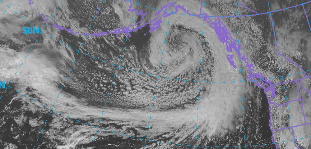 This is a textbook example of a large, powerful extratropical cyclone. Satellite image taken late Saturday afternoon. Take note of the prominent comma shape.