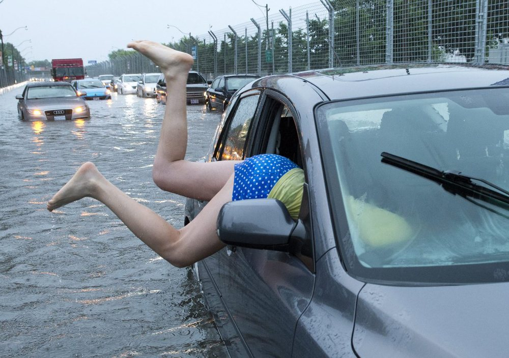 Sometimes, we must admit, the weather catches us off guard. Photo: Toronto, ON during the August 2013 floods (AP)