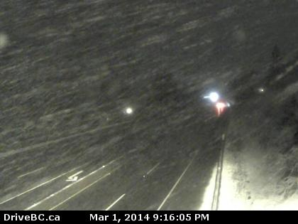 Current webcam on eastern Vancouver Island showing snow beginning to fall this evening