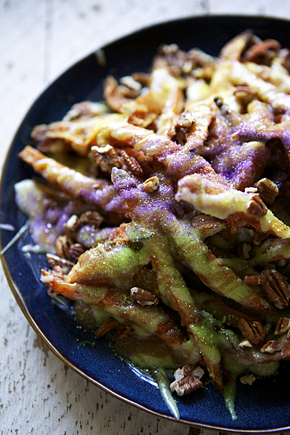 king cake fries — cinnamon sugar sweet potato fries topped with brown butter cream cheese glaze and pecan praline sauce // Glazed & Confused #mardigras #kingsday
