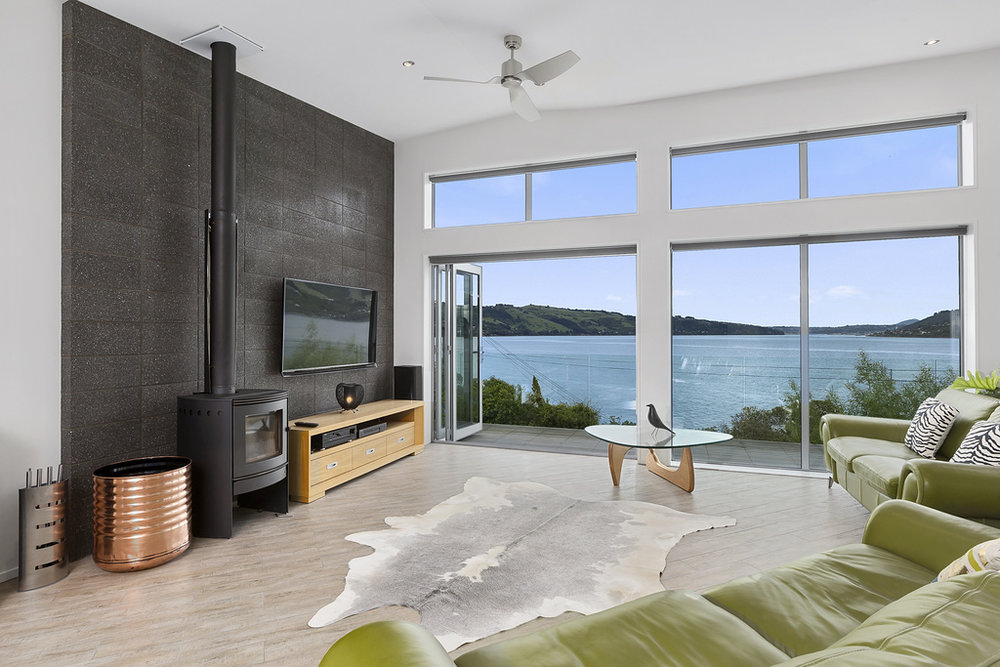Resene Black White  provides a crisp fresh backdrop to this harbour view creating visual space for treasured artwors