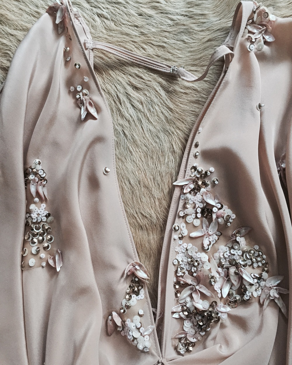 The Baby Joey Playsuit is fizzing with organic floral sequins, crystals and seashells; all hand tacked to an ultra-fine silk crepe that melts across the wearer.